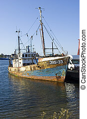 rusty ship - ruined ship in port with rust
