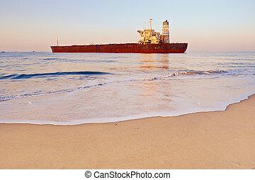 Rusty Ship - Rusty ship on the shoreline in the Goa, India