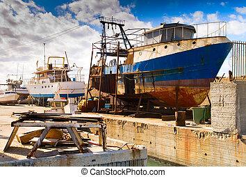 Rusty ship - Rusty stationary ship on dockyard