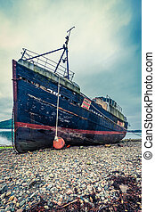 Rusty ship wreck in Fort William, Scotland