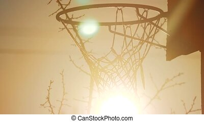 Rusty silhouette sunrise sunset urban basketball hoop. view...