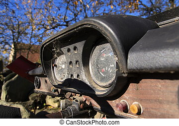 Rusty speedometer on the vintage car control panel