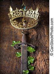 Rusty sword and golden crown