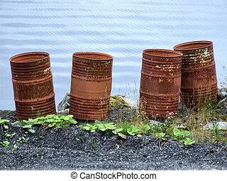 Rusty waste barrels