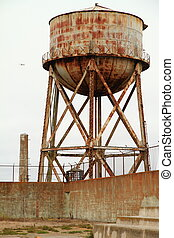 Rusty Water Tank in alcatraz on a cloudy day