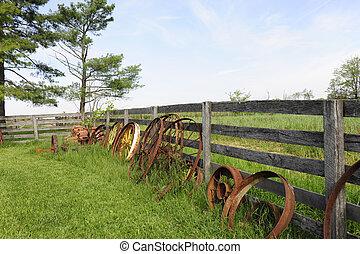 Rusty Wheel, Rustic Fence - Rusty wagon wheels leaning...