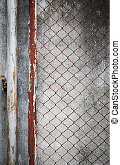 rusty wire fence with cement wall grunge background