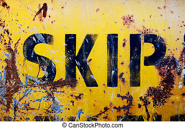 Rusty yellow skip - The side of a rusty industrial skip or ...