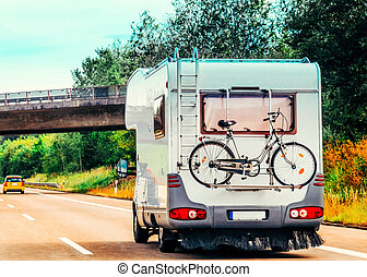 RV Camper Car with bicycle on Road in Switzerland