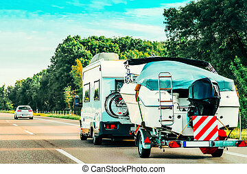 RV Camper Car with bicycles on Road in Switzerland