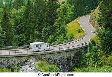 RV Camper Van Trip. Camper Van on the Mountain Road Bridge...