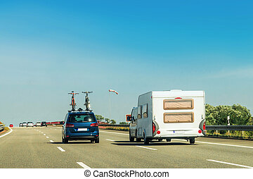 RV Camper with bicycles and car on Road at Switzerland