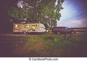 RV Camping Adventure. SUV Pulling Travel Trailer. Camper...