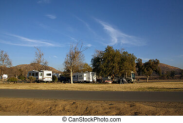 RV Campers Parked in Campsites in the Desert
