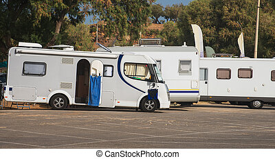 RV Camping. Three recreational vehicles.