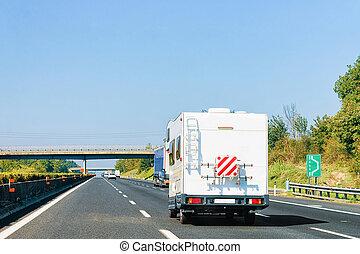 RV Caravan Car on Road Camper and motorhome Italy