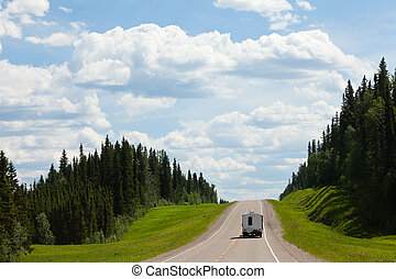 RV drives Alcan south Fort Nelson BC Canada - Recreational...
