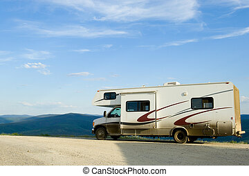 RV on the road - Recreational vehicle on Alaskan dirty road...
