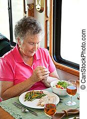 RV Senior Woman Says Grace