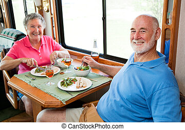 RV Seniors - Dinner for Two - Senior couple enjoying a...