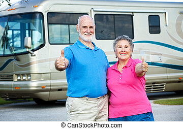 RV Seniors - Happy Retirement - Senior couple posing in...