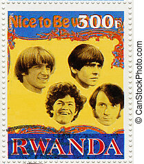 RWANDA - CIRCA 2003 : stamp printed in Rwanda shows the Monkees american pop rock group popular in 1960th, circa 2003