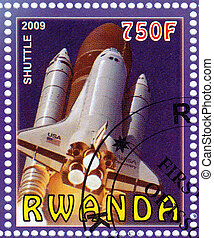 RWANDA - CIRCA 2009 : stamp printed in Rwanda shows shuttle NASA in space mission, circa 2009