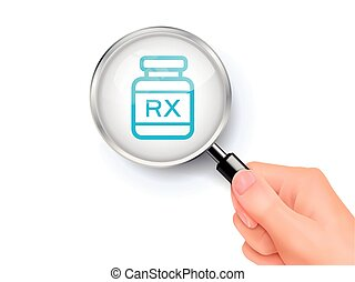 Rx icon sign showing through by magnifying glass held by...