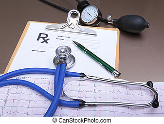 RX prescription, Red heart, pills, blood pressure meter and a stethoscope on table.