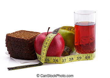 Rye bread apples and juice in glass on a white background with a measuring tape