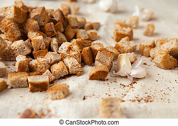 rye bread croutons on fabric, food close up