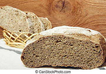 Rye bread on a wooden background, close-up