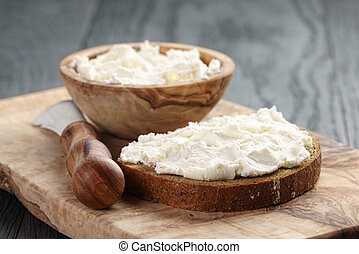 rye bread with cream cheese on wood table