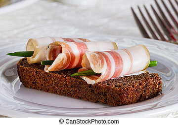 Rye bread with salty bacon