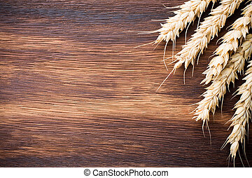 Rye. - Rye bunch on a wooden table. Wooden background.