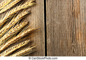 Rye spikelets over wooden background - Rye spikelets on ...
