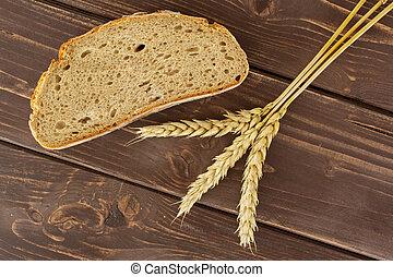 Rye wheat bread on brown wood