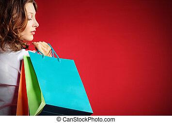 säcke, frau- einkaufen, besitz, gegen, hintergrund, rotes