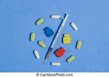 sätta, av, olika, lertavlor, kapsyler, injektionsspruta, på, blå, bakgrund., medicin, skapande, concept.