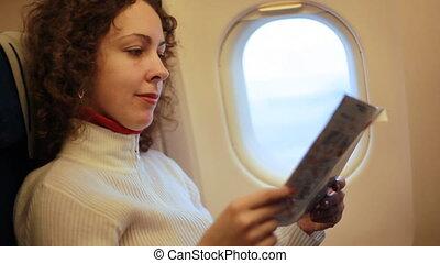 séance femme, fauteuil, magazine, avion, lecture