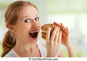séduisant, jeune femme, mange, nourriture malsaine, hamburger