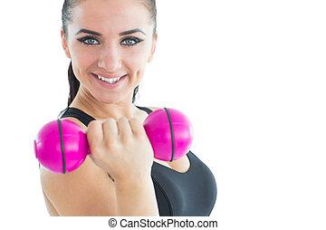 séduisant, sportif, fond, quoique, haltère, formation, sourire, appareil photo, blanc, femme, rose