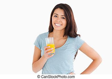 séduisant, tenue, jus orange, verre, femme