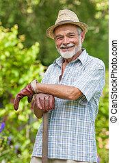 sênior, jardineiro, pá