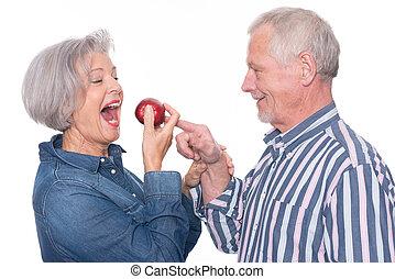Sênior, par, maçã