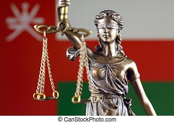 símbolo, de, ley, y, justicia, con, omán, flag., cierre, arriba.