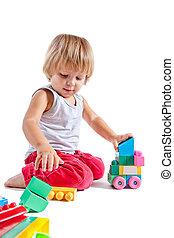 söt, liten pojke, spelande leksaker