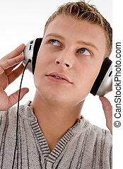 słuchawki, człowiek, do góry szczelnie
