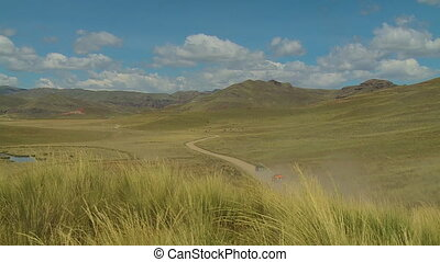 S-Curved Road On A Hilly Landscape, Andes, Peru - Wide still...