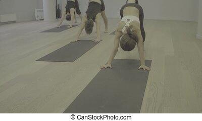 S log yoga class man doing yoga asanas Video and Stock
